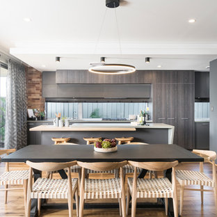 Inspiration for a beach style kitchen/dining combo in Perth with light hardwood floors, beige floor and grey walls.