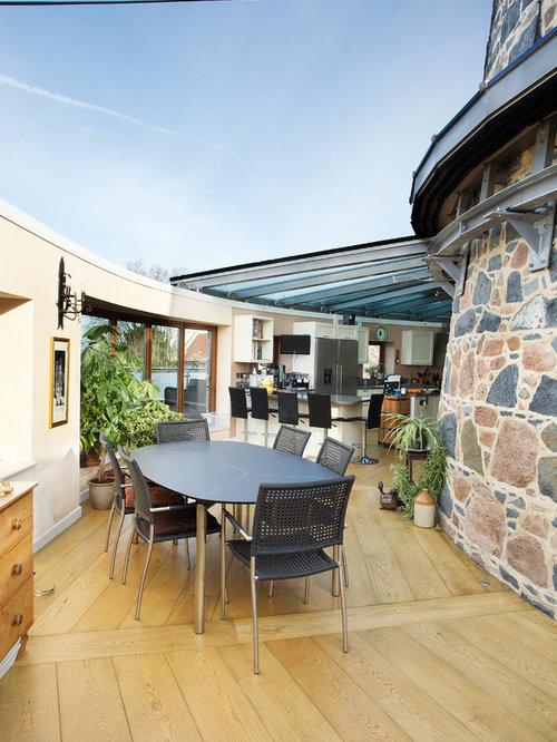 Trendy Light Wood Floor Great Room Photo In Channel Islands With Beige Walls