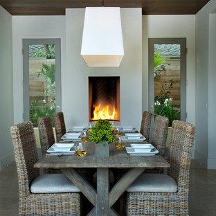 Идея дизайна: отдельная столовая среднего размера в стиле современная классика с стандартным камином, белыми стенами, полом из керамической плитки и бежевым полом