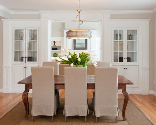 Traditional Medium Tone Wood Floor Dining Room Idea In Boston With Beige Walls