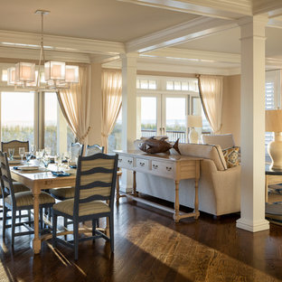 Inspiration for a beach style dark wood floor and brown floor great room remodel in New York with beige walls