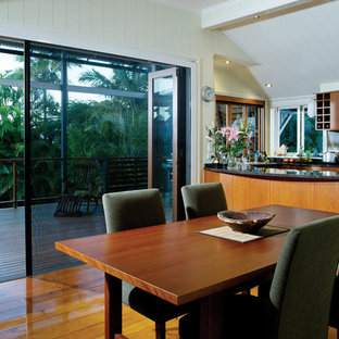 Enclosed dining room - mid-sized modern medium tone wood floor and brown floor enclosed dining room idea in Hawaii with white walls and no fireplace