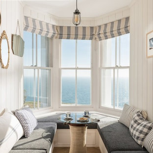 Photo of a medium sized coastal dining room in Cornwall with beige walls.