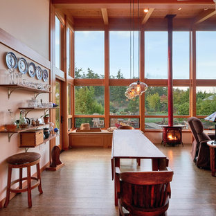Example of a mid-sized trendy medium tone wood floor great room design in Seattle with a wood stove and white walls
