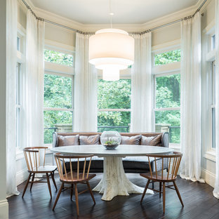 Transitional dark wood floor dining room photo in Portland with white walls