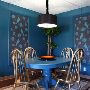 Eclectic dining room in Los Angeles with blue walls.