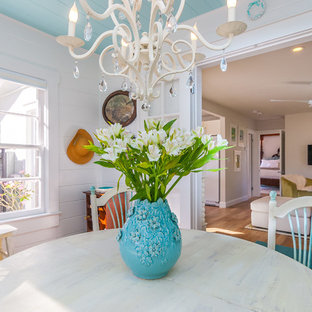 Design ideas for a small shabby-chic style dining room in Tampa with white walls and light hardwood floors.