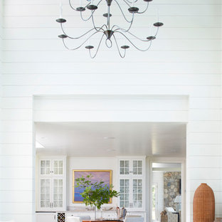 Huge transitional enclosed dining room photo in Portland Maine with white walls