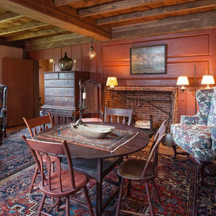 Country dining room photo in Boston with red walls and a standard fireplace