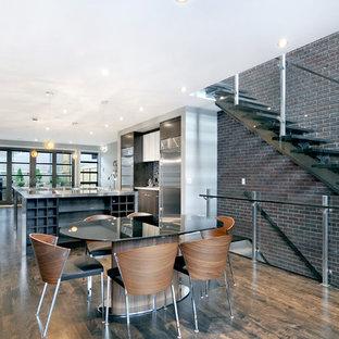 Kitchen/dining room combo - modern dark wood floor kitchen/dining room combo idea in Calgary with white walls