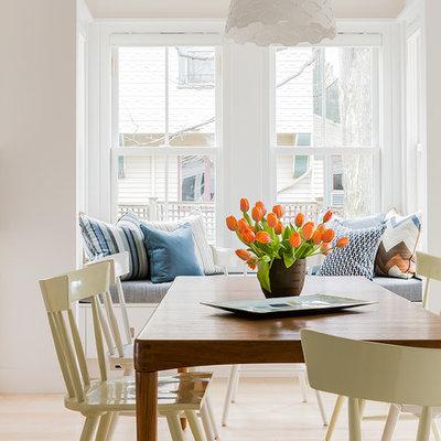 Dining room - scandinavian light wood floor dining room idea in Boston with white walls