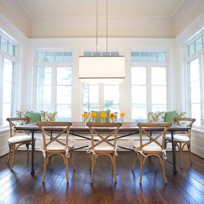 Elegant dark wood floor dining room photo in Dallas with beige walls