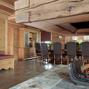 Imagen de comedor ecléctico con suelo de baldosas de cerámica, chimeneas suspendidas, marco de chimenea de madera y suelo marrón