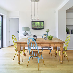 Inspiration for a medium sized contemporary kitchen/dining room in Hertfordshire with white walls, medium hardwood flooring and brown floors.
