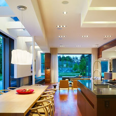 Contemporary Dining Room by SCE Construction Management Inc.