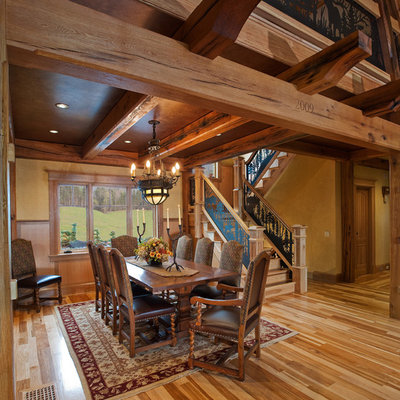 Inspiration for a rustic medium tone wood floor dining room remodel in New York with beige walls