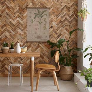 Esempio di una grande sala da pranzo aperta verso il soggiorno shabby-chic style con pareti bianche, pavimento in cemento, nessun camino e pavimento beige