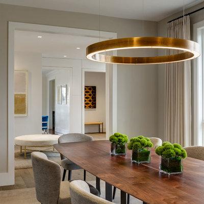 Trendy beige floor and dark wood floor dining room photo in New York with beige walls