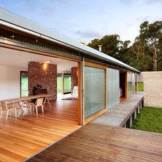 Industrial Dining Room by Maxa Design