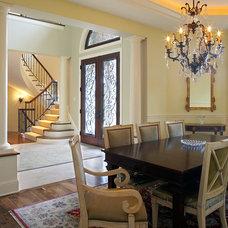 Mediterranean Dining Room by Erotas Building Corporation