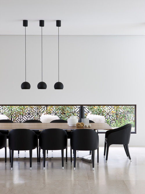 Modern Dining Room Idea In Melbourne With White Walls