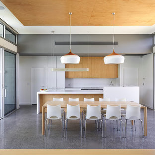 Inspiration for a contemporary dining room in Adelaide with white walls and no fireplace.