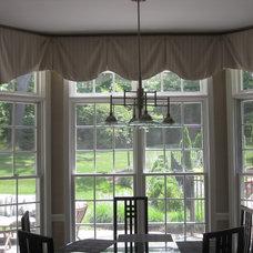 Eclectic Dining Room by R Garner Custom Designs, LLC