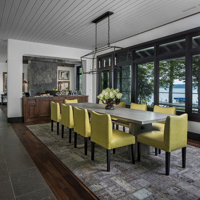 Inspiration for a coastal dark wood floor great room remodel in Detroit with white walls and no fireplace
