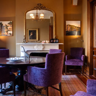 Inspiration pour une salle à manger victorienne fermée et de taille moyenne avec un mur marron, moquette, une cheminée standard et un manteau de cheminée en bois.