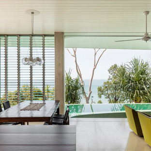 Design ideas for a tropical dining room in Cairns.