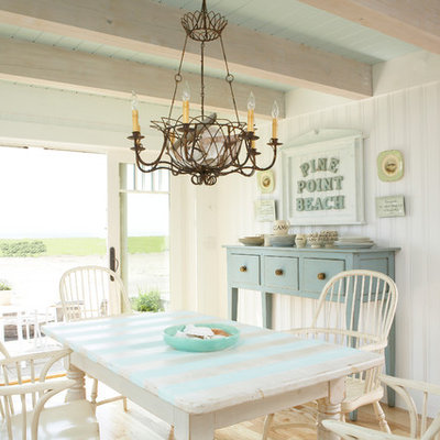 Kitchen/dining room combo - mid-sized coastal light wood floor and brown floor kitchen/dining room combo idea in Tampa with white walls