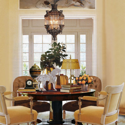 Example of a large classic carpeted enclosed dining room design in Other with yellow walls