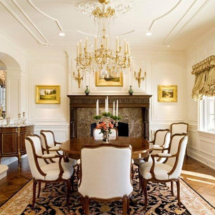 Dining room - traditional medium tone wood floor dining room idea in Philadelphia with white walls and a standard fireplace