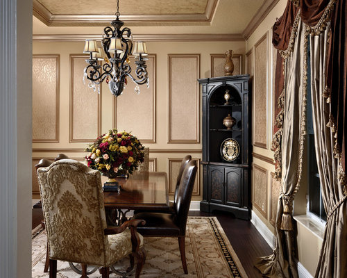 example of a classic dark wood floor enclosed dining room design in miami with beige walls