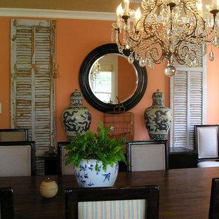 Idee per una sala da pranzo shabby-chic style con pareti arancioni