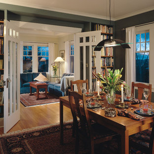 Example of a classic dining room design in Seattle with green walls