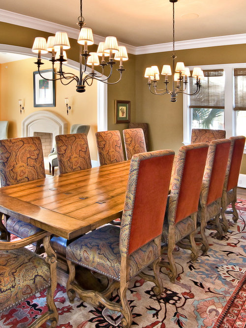 Example Of A Classic Dining Room Design In Charleston With Brown Walls