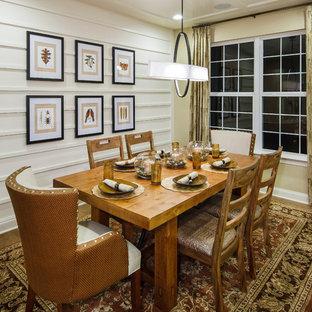Elegant medium tone wood floor dining room photo in Philadelphia with white walls