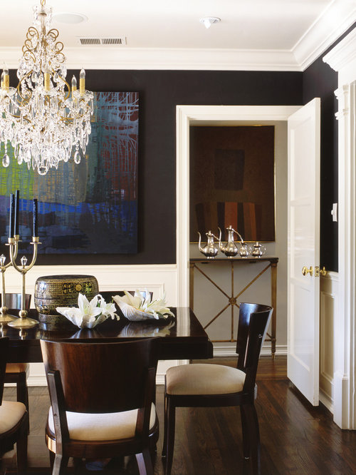 Elegant Dark Wood Floor And Brown Floor Dining Room Photo In Los Angeles  With Black Walls
