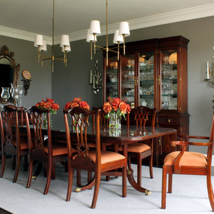 Dining room - traditional dark wood floor dining room idea in Chicago with gray walls