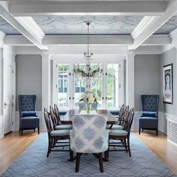 Traditional dining room with wall papered ceiling