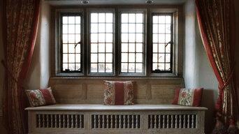 Traditional farmhouse window seat and stone mullion windows.