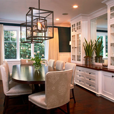 Enclosed dining room - mid-sized traditional dark wood floor enclosed dining room idea in Orange County with black walls and no fireplace