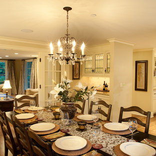 Inspiration for a mid-sized timeless medium tone wood floor enclosed dining room remodel in Seattle with beige walls and no fireplace
