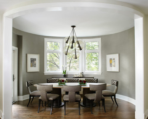 Example Of A Trendy Dark Wood Floor Enclosed Dining Room Design In Chicago With Gray Walls