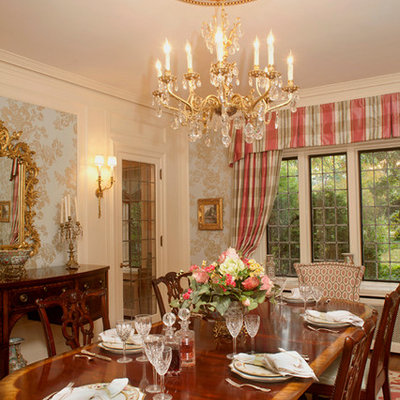 Example of a classic enclosed dining room design in Cleveland with white walls