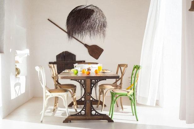 Mediterranean Dining Room by Kima design&build