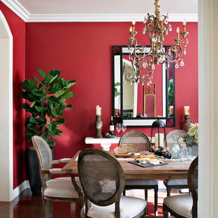 Example of a mid-sized classic dark wood floor enclosed dining room design in San Diego with red walls