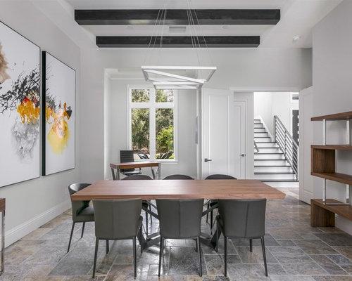 Salle à manger avec un sol en travertin et un mur gris : Photos et ...