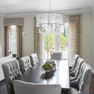 Inspiration for a mid-sized transitional dark wood floor and brown floor great room remodel in Los Angeles with beige walls and no fireplace
